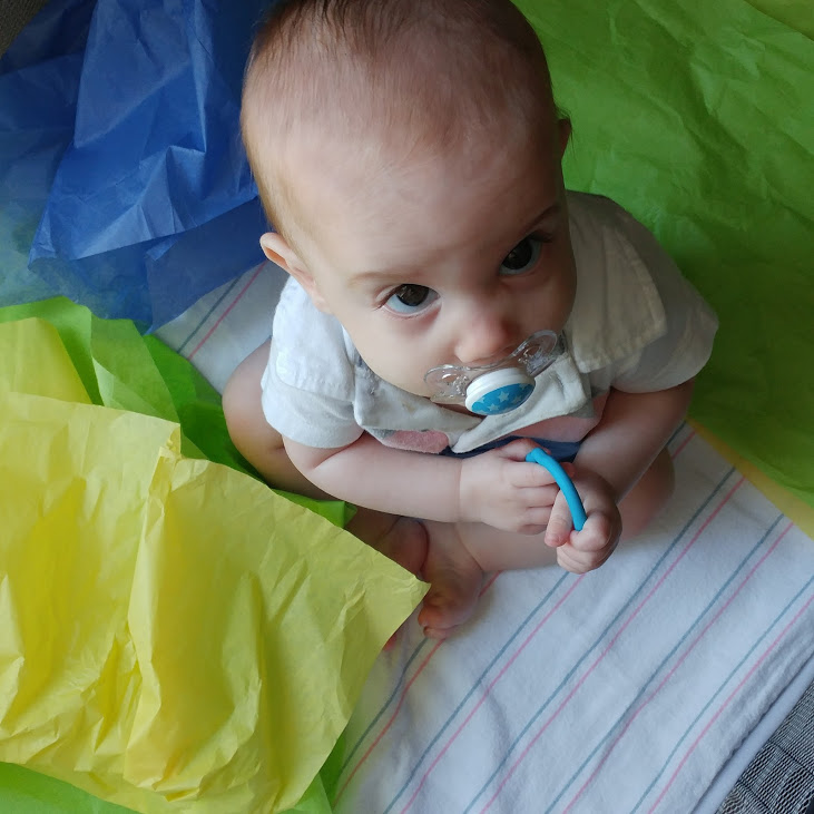 baby play tissue paper - discovering the world through simple sensory play